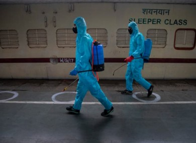 File photo. Health workers sanitising a train.