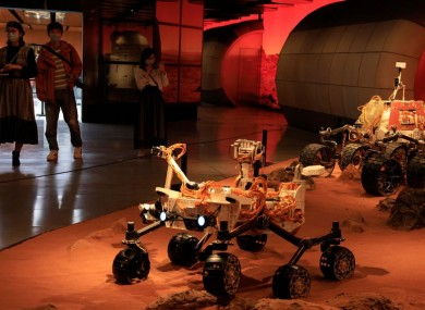 China, which hosts this depiction of a Chinese lander in a Mars-like environment in Beijing, recently brought lunar samples back to Earth