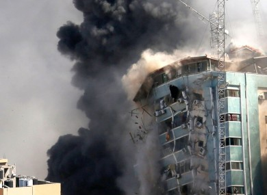 The building housing the offices of The Associated Press and other media in Gaza City collapsed after it was hit by an Israeli air strike on Saturday