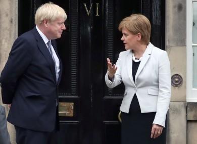 Scotland's First Minister Nicola Sturgeon and UK Prime Minister Boris Johnson outside Bute House in Edinburgh.