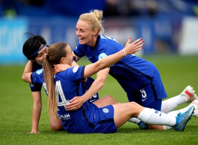 Chelsea's Fran Kirby (centre) celebrates with her team-mates after scoring their side's fourth goal.