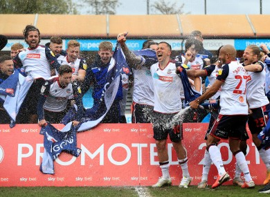 Bolton Wanderers celebrate sealing promotion to League One.