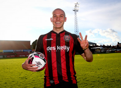 Bohs' Georgie Kelly celebrates with the match ball after scoring a hat-trick.