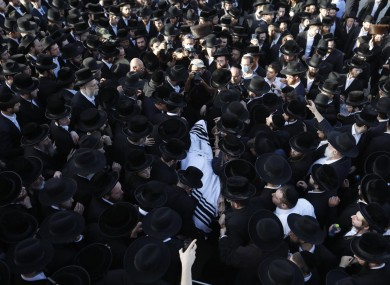 Mourners carry the body of Shragee Gestetner, a Canadian singer who died during Lag BaOmer celebrations at Mt Meron. 30 April.