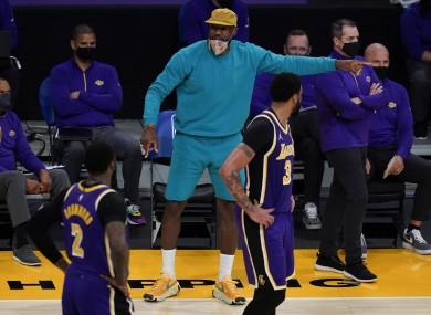 Injured Los Angeles Lakers forward LeBron James talks to his team-mates.