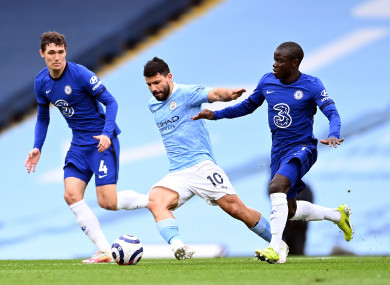 Sergio Aguero is tracked by Chelsea's Andreas Christensen and N'Golo Kante.