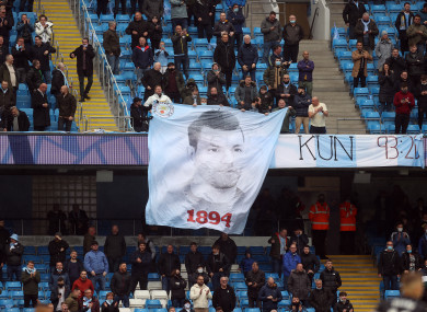 Manchester City fans unfurl a banner in the stands for Sergio Aguero.