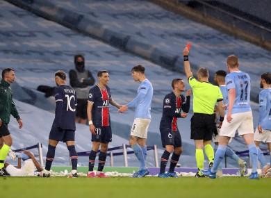 Paris Saint-Germain's Angel Di Maria (no.11) is shown a red card.