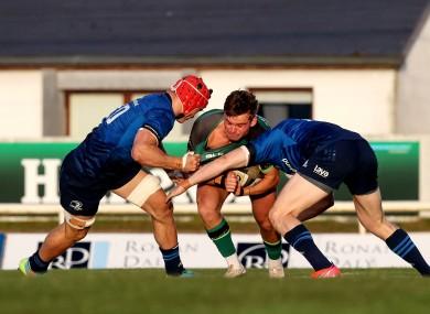 Oran McNulty is tackled by Josh van der Flier.