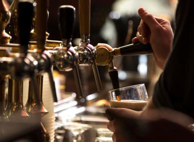 File photo of a barman pulling pints