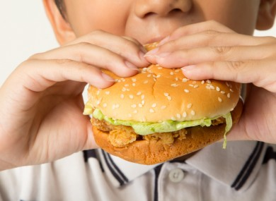 File photo of a child eating a burger