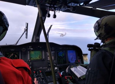 Inside the Irish Air Corps helicopter flying in formation behind the US Seahawk.