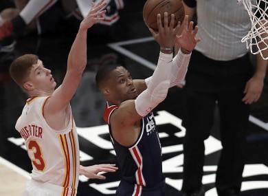 Westbrook (right) shoots past Atlanta's Kevin Huerter.