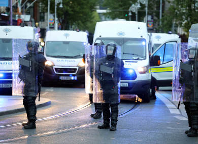 Members of the public order unit in riot gear in the city centre last night.