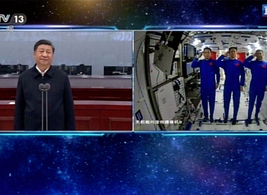 Composite pic showing Chinese astronauts saluting as they talk with Chinese President Xi Jinping
