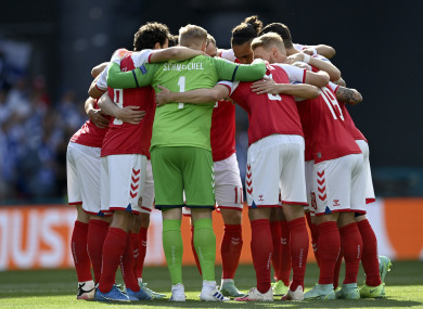 The Denmark team in a huddle prior to yesterday's Euro 2020 fixture against Finland in Copenhagen.