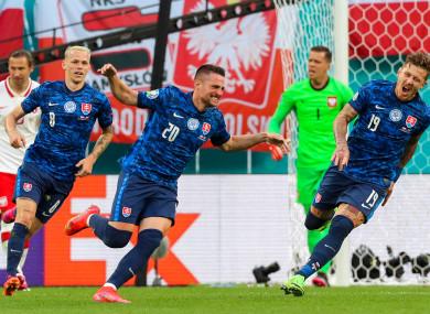 Slovakia's Robert Mak (centre) celebrates his goal.