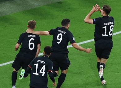 Leon Goretzka celebrates scoring.
