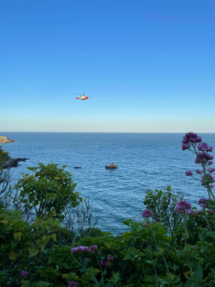 The emergency lifeboat and Rescue 116 helicopter on the coast line