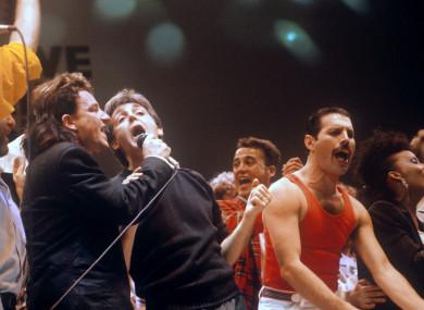 Bono, Paul McCartney and Freddie Mercury at Live Aid in 1985.