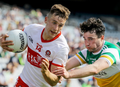 Derry's Shane McGuigan and Eoin Rigney of Offaly.