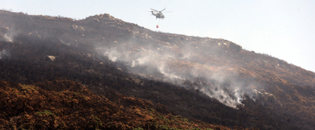 An Air Corps helicopter fire fighting in Howth.