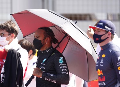 Mercedes' Lewis Hamilton (middle) and Red Bull's Max Verstappen (R) prior to the start of the British Grand Prix.
