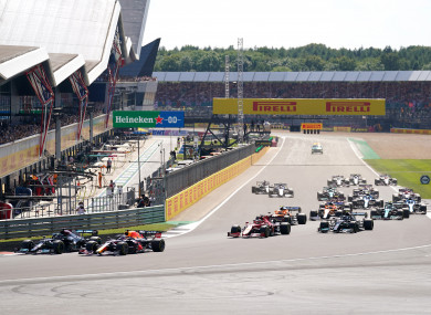 Max Verstappen and Lewis Hamilton leading the race during the British Grand Prix.