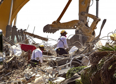 Rescue teams from Pennsylvania, search the rubble of the Champlain Towers in Surfside, Florida.