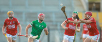 Cork and Limerick players in action.