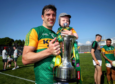 David Moran celebrates after the game with his son Eli.