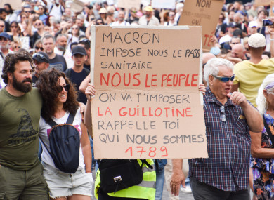 A protester holds a placard during the demonstration against the health pass in Marseille.