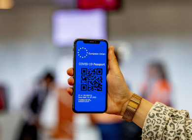 A Covid passport with a QR code on a mobile phone at Rotterdam the Hague airport, Netherlands.