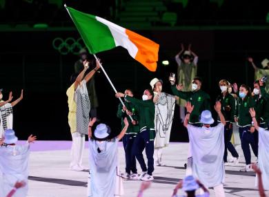 Kellie Harrington and Brendan Irvine carry the flag for Team Ireland.