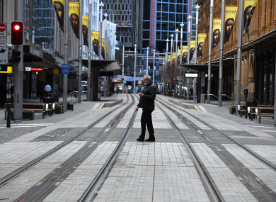 A pedestrian walks along George St in the central business district in Sydney