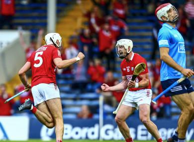 Tim O'Mahony celebrates his goal with Cork team-mate Patrick Horgan.