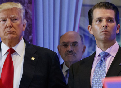 Donald Trump and his son Donald Junior with Allen Weisselberg centre.