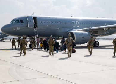 Hungarian soldiers escorting evacuees to a Hungarian Air Force plane in Kabul last week.