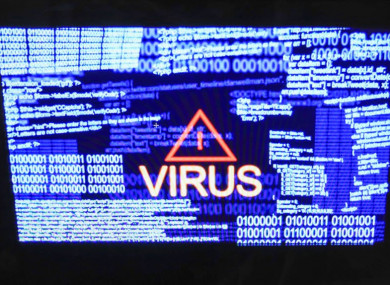 File photo of a virus on a computer