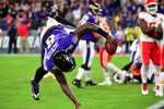 Lamar Jackson celebrates scoring the winning touchdown.