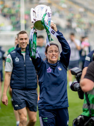 Limerick's Caroline Currid celebrates with the Liam MacCarthy cup.