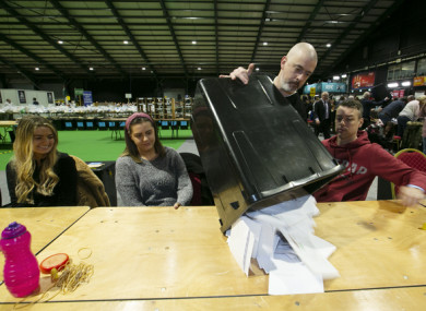Count staff emptying ballot boxes for counting at the RDS in Dublin in February 2020.