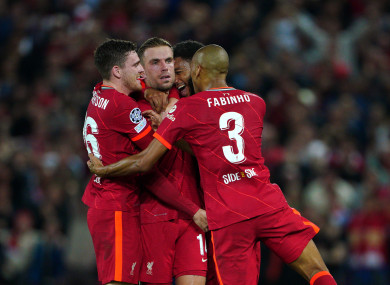 Liverpool's Jordan Henderson (centre) celebrates scoring.