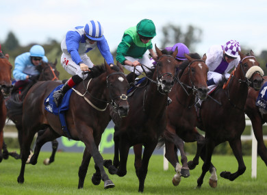Colin Keane riding Atomic Jones (left) on their way to winning the KPMG Champions Juvenile Stakes.