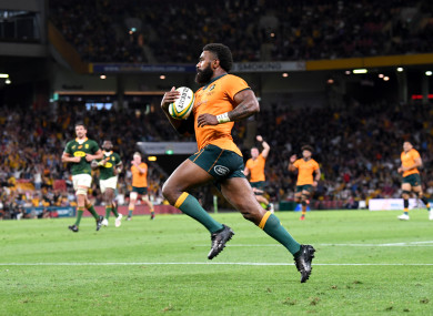 Marika Koroibete of the Wallabies on his way to score a try.