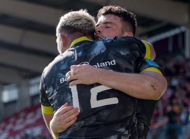 Dan Goggin and Calvin Nash celebrate a Munster try.