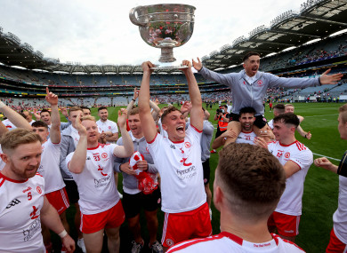 Tyrone's Conn Kilpatrick celebrates with the Sam Maguire.