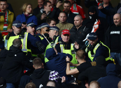 Fans clash with police during the game.